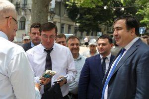 Handing of genetic badge to Lutsenko